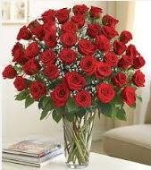 Cam vazoda 51 kırmızı gül süper indirimde  İstanbul Kadıköy uluslararası çiçek gönderme